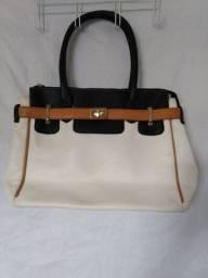 Bolsa de couro Branca e azul marinho.