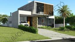 Casa no condomínio Ninho Verde, 3 suítes, frente ao asfalto, Imobiliária Paletó