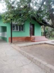 Casa 3 dormitórios com amplo pátio na Vila Nova próximo rótula do hospital