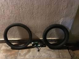 Par de pneus meia vida + par de retrovisor