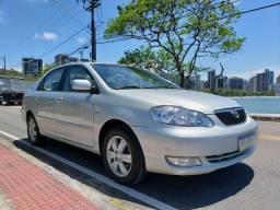 Toyota Corolla Seg 1.8 automático ar digital prata carro de mulher 2007 - 2007