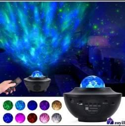 Caixinha de som/ projetor de luzes e estrelas