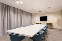 Os benefícios do coworking com sua própria mesa privativa.
