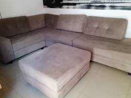 Sofa de canto com estofado central