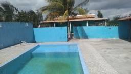 Chácara com piscina, churrasqueira e tanque