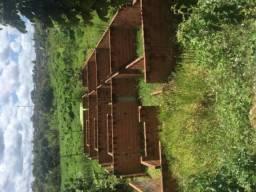 Terreno com casa meia construída