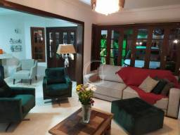 Casa com 4 dormitórios à venda, 161 m² por R$ 700.000,00 - Centro - Torres/RS