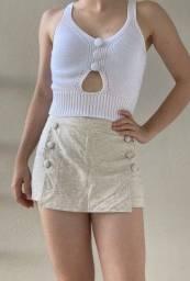 Top cropped branco de tricô/ crochê