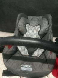 Bebê Conforto Touring Evolution Semi novo e pouco usado em perfeito estado .