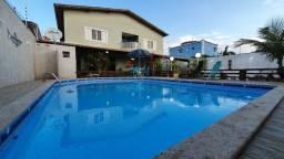 Casa com piscina e churrasqueira com 05 quartos em Nova Guarapari