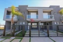 Sobrado à venda, 102 m² por R$ 440.000,00 - Morada das Palmeiras - Torres/RS