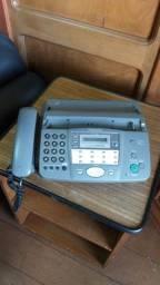 1 aparelho de telefone/fax
