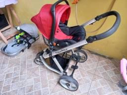 Carrinho de bebê fisher-price com bebê conforto