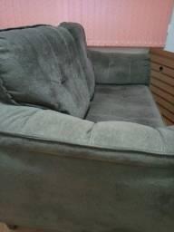 Vendo sofá  de dois lugares,forro em camurça, estrutura em madeira muito novo!
