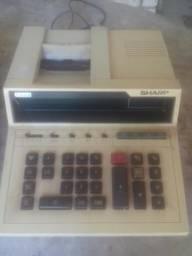 2 maquinas calculadoras e nota