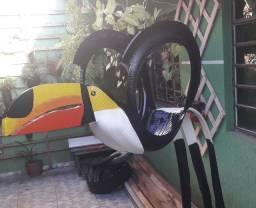 Floreira de pneu formato de tucano