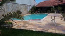 Casa com 3 dormitórios à venda, 180 m² por R$ 650.000,00 - Balneário das Conchas - São Ped
