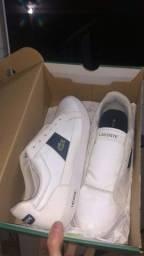 Estou vendendo tênis da locoste cor branco número 42 novo com caixa e tudo