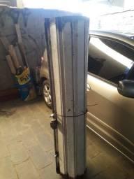 Porta de aço para loja 1.50 larg 2.53 alt com eixo e molas