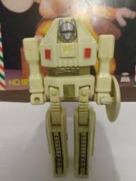 Boneco Transformers anos 80 ( com acessórios )