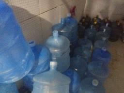 Garrafões de água mineral + bicicleta