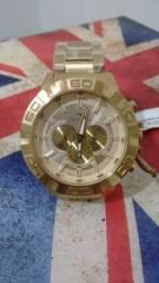 Relógio technos dourado grande