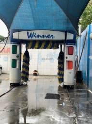 Máquina de ducha de posto.