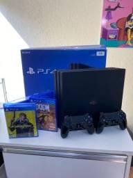 PS4 pro com 2 controles e 2 jogos