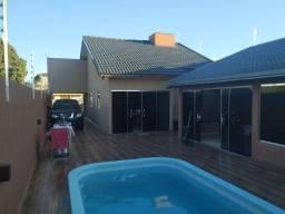 Casa com edícula e piscina