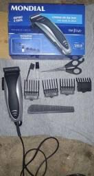 Máquina de cortar cabelo semi nova