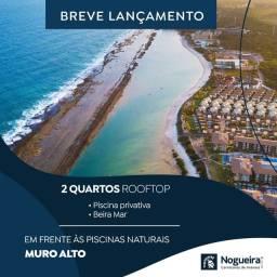 Título do anúncio: AP 2/3 qts  rooftop na beira mar? de muro alto