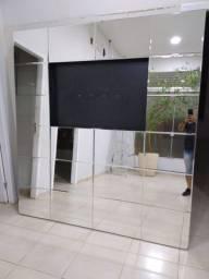 Painel para TV de vidro bisotê