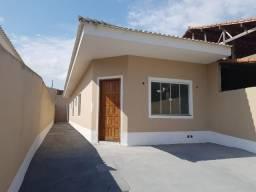 Casa com 02 quartos, amplo espaço para fazer área gourmet, rua asfaltada