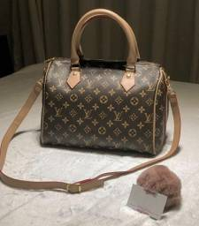 Bolsa Baú Louis Vuitton
