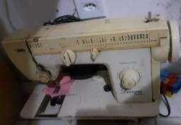 Vende máquina de costura.