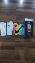 Caneleira Nike
