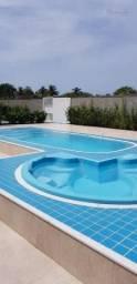 Village com 2 dormitórios à venda, 60 m² por R$ 240.000 - Massaguaçu - Caraguatatuba/SP