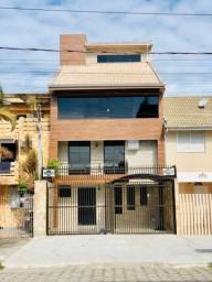 Título do anúncio: Triplex  para venda com piscina coberta localizado no  Centro - Guaratuba - Paraná