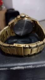 Relógio Téchnos dourado