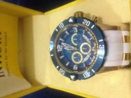 e6970599b8f Relogio Invicta original pulseira branca fundo azul