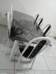 Vendo mesa com 8 cadeiras muito nova  e mais esse rack pequeno