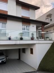 Sobrado na Cidade Parquelandia, com 4 quartos, sendo 3 suítes e área útil de 295 m²