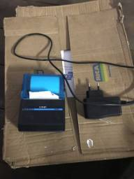 Impressora térmica portátil e caixa com bobinas pra sair logo!