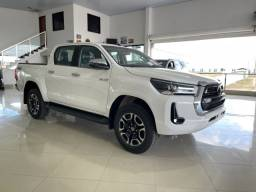 Título do anúncio: Toyota Hilux Srx 2.8 Branco Polar 21/21 Zero Diesel Pronta Entrega