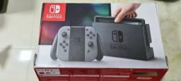 Nintendo switch com case de acrílico e 4 jogos secundário completo