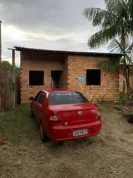 Troco carro e casa em uma casa