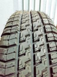 Pneus aro 13 Pirelli com rodas de ferro.
