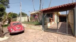 Casa com 3 dormitórios para alugar, 126 m² por R$ 2.500,00/mês - Rubem Berta - Porto Alegr