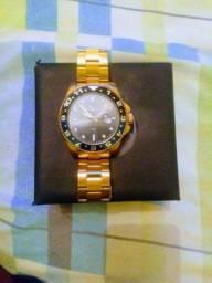 Relógio Mondaine dourado Hosana time