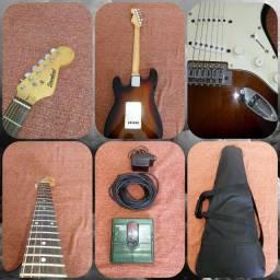 Guitarra Strimberg e pedaleira zoom 505